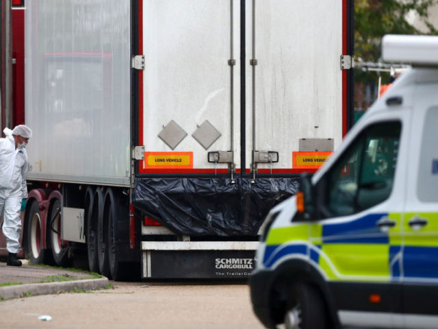 Police are seen at the scene where bodies were discovered in a lorry container, in Grays, Essex, Britain October 23, 2019 UK Lorry Migrants Left 'Bloody Handprints' Inside Container After Desperately 'Banging for Help'
