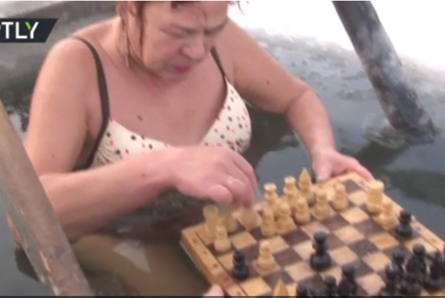 Russian granny plays chess in ice hole, needs multiple men to sustain her hobby (VIDEO)