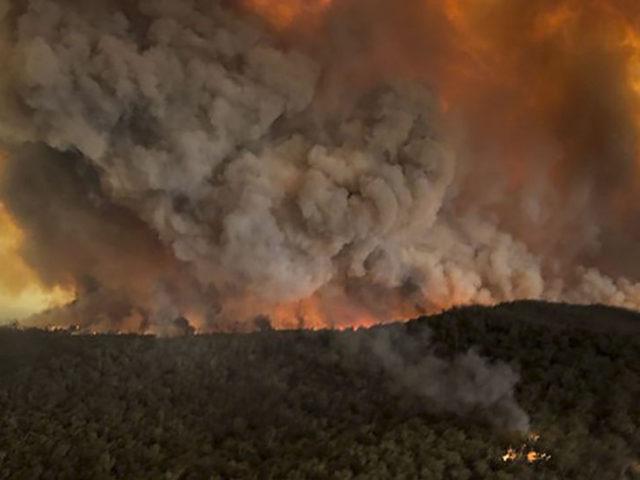 Videos: Australian Bushfires Merge Into 1.5 Million-Acre Blaze