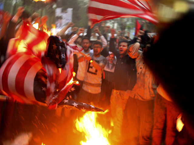 Businessman Explains How to Earn a Living in Iran From Burning US, UK & Israeli Flags