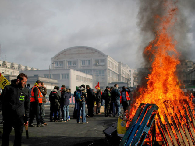 France's economy caves under pressure of massive protests