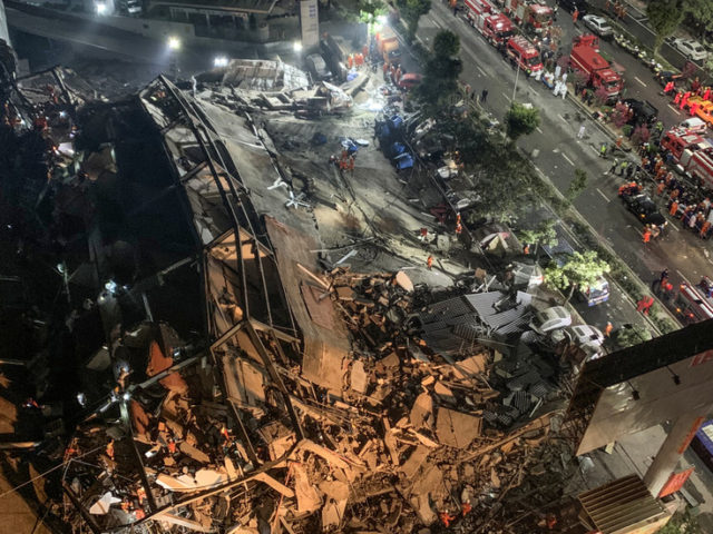Chinese hotel used as Covid-19 quarantine site COLLAPSES, trapping dozens under rubble (VIDEOS)