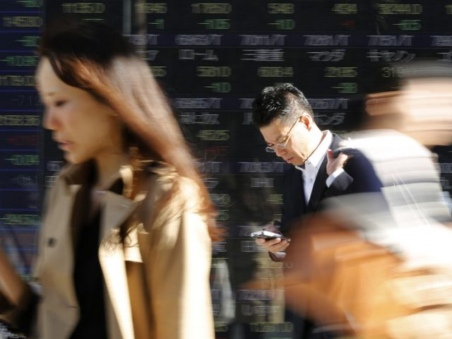 'Smartphone zombies' BANNED from texting while walking in Japanese city
