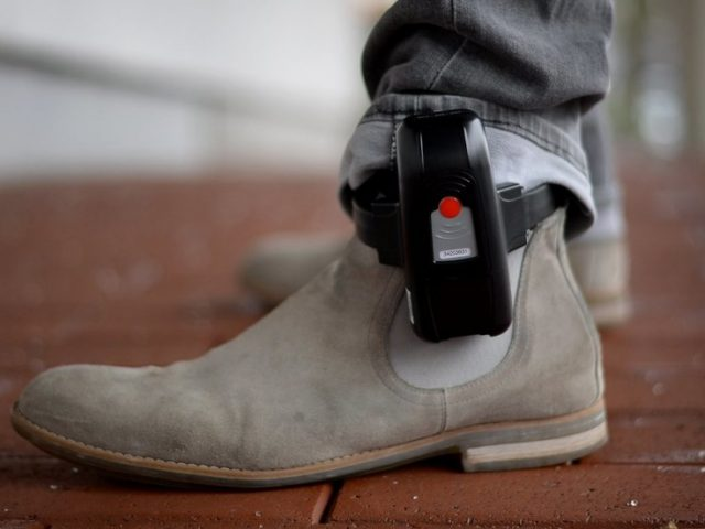 Ankle monitors, house arrest, & armed guards: Covid-19 enforcement measures ramp up even as lockdowns wind down