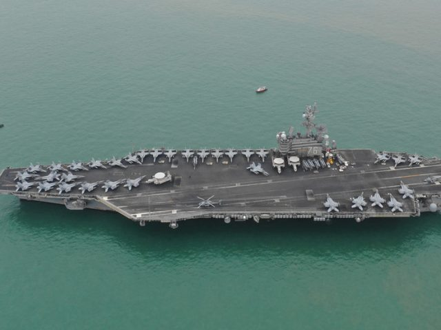 Beijing slams US for 'flexing muscles' in South China Sea as aircraft carriers sent to 'celebrate Independence Day'