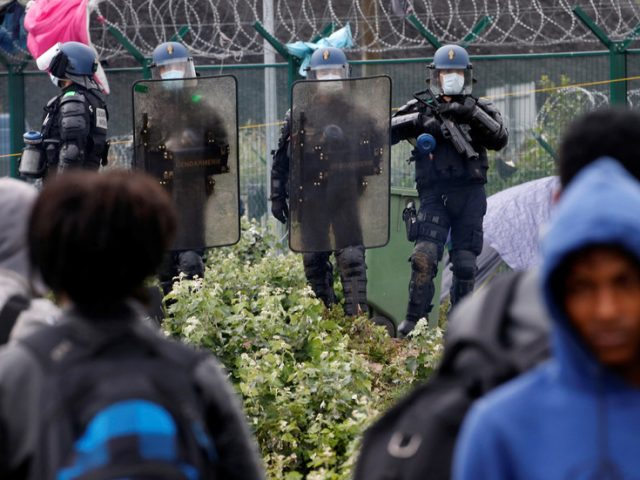 French police DESTROY Calais migrant camp and send over 500 to reception centers