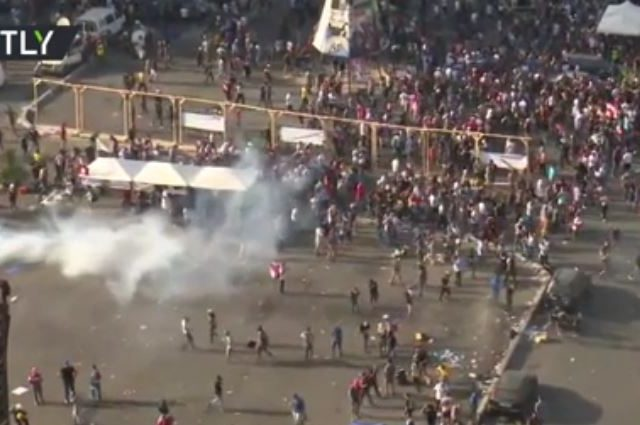 Police deploy tear gas as Lebanon protesters try to break into parliament building following massive Beirut explosion