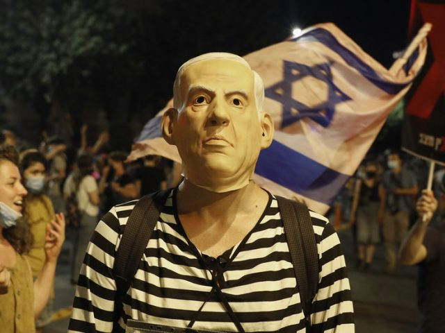 Netanyahu calls anti-govt rallies 'BIZARRE' as he defends his son Yair's 'alien protesters' comment