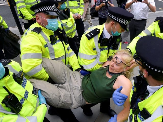 'Flipping nuisance': Senior UK cop blasts Extinction Rebellion activists' tactic of 'GOING ALL FLOPPY' to make arrests harder