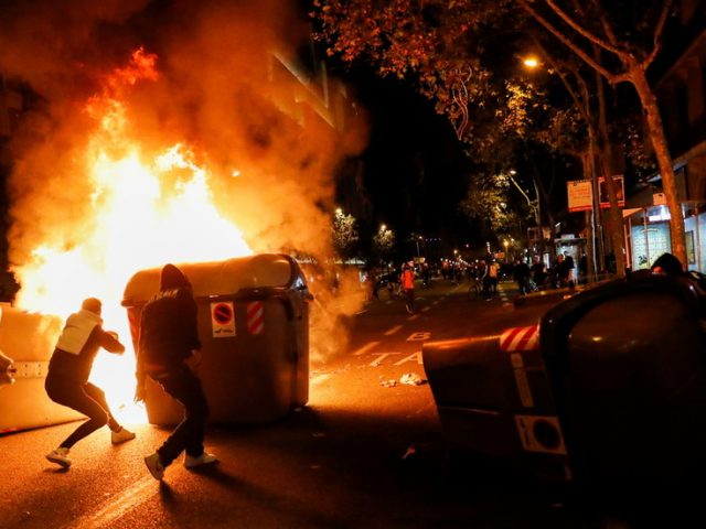 Violent clashes in Barcelona as protesters hurl missiles at police after Catalonia closes borders over Covid (VIDEOS)
