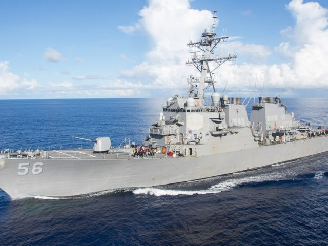 Chinese military urges US to stop 'provocative actions' in South China Sea as USS John McCain enters disputed waters