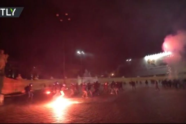 Fireworks vs. batons: Italian far-right clash with riot police over 'dictatorship' of Covid-19 rules (VIDEO)