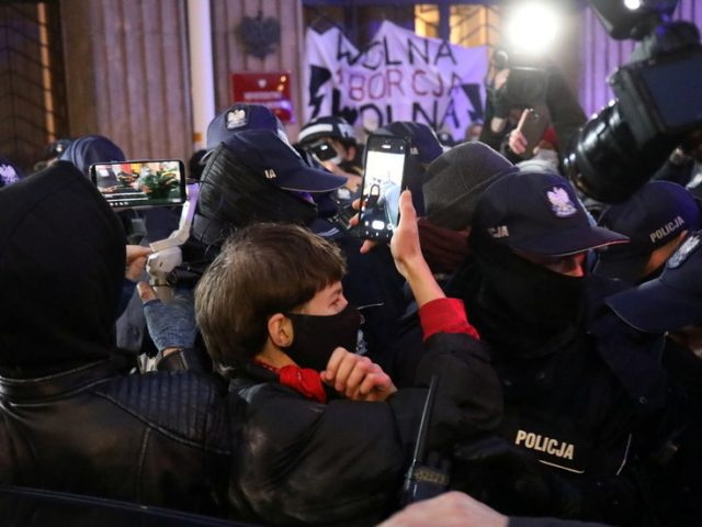 Clashes in Poland as police remove pro-choice activists chained to Warsaw's Ministry of Education