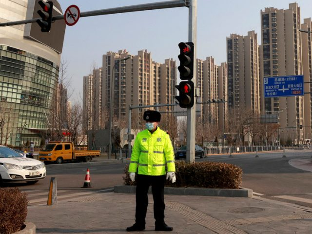 Beijing back in partial lockdown after new coronavirus cases emerge in airport district