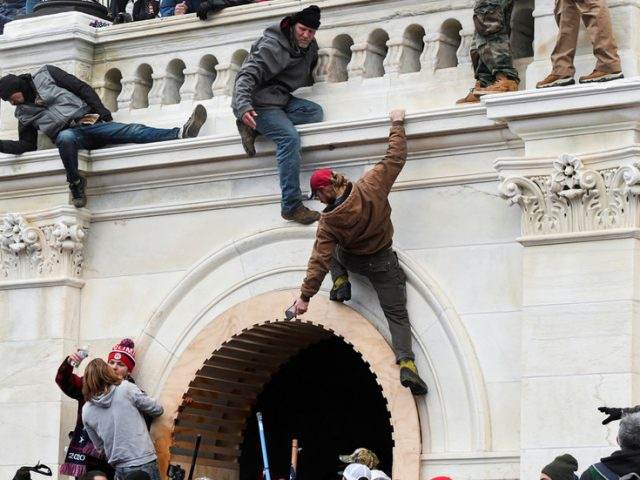DOJ investigating whether 'national security secrets' stolen during US Capitol siege as more protesters are arrested