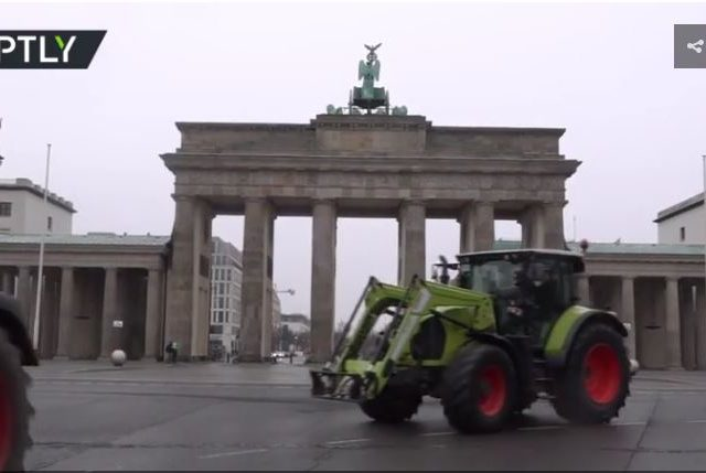 German farmers drive their tractors by Brandenburg Gate with message: 'Don't kill farms to save bugs' (VIDEO)