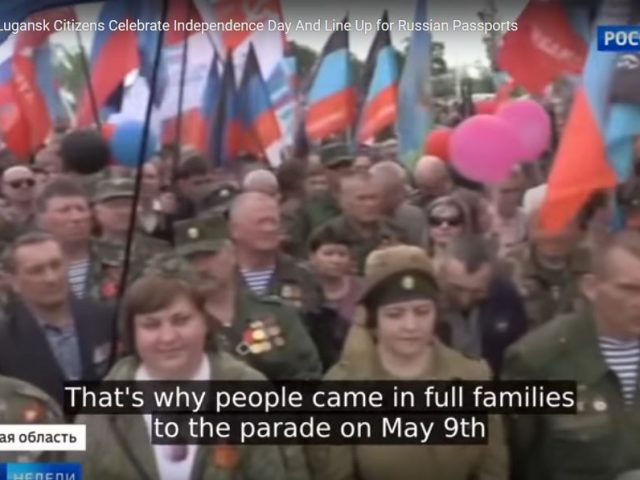 Donetsk and Lugansk Citizens Celebrate Independence Day And Line Up for Russian Passports