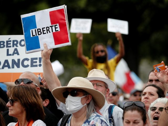French parliament approves bill forcing vaccination for medical workers & greater health pass use amid growing protests