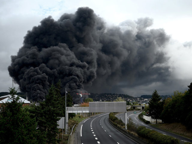 Nothing to worry about? French authorities admit over 5,200 tons of chemicals went up in flames during recent blaze in Rouen