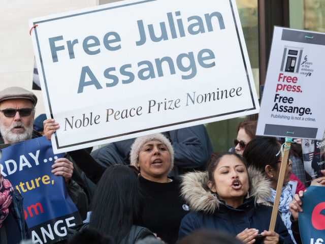 Julian Assange to remain locked up in UK prison following brief court appearance ahead of US extradition hearing