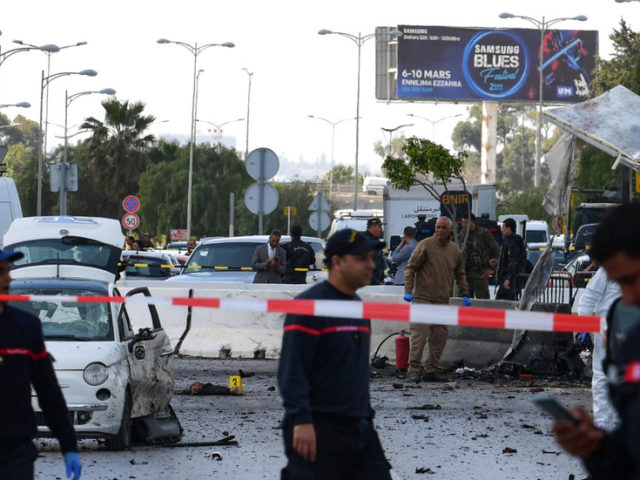 Policeman killed, several injured as militant bombers blow themselves up in front of US embassy in Tunis