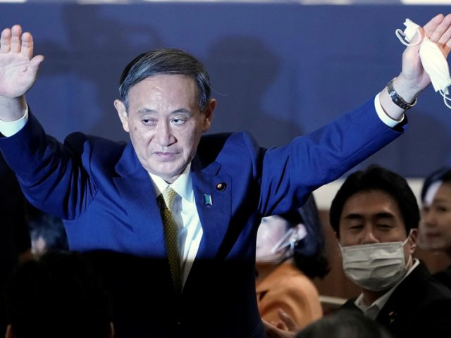 Abe's 'loyal right-hand man' Yoshihide Suga chosen by ruling party to succeed him as Japan's PM