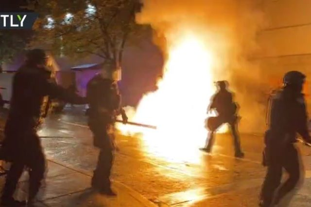 WATCH rioters throwing Molotov cocktails at police in Portland amid nationwide protests over Breonna Taylor case