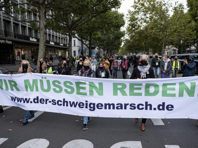 No to 'permanent fear campaigns': Thousands of anti-lockdown protesters decry government restrictions in Berlin