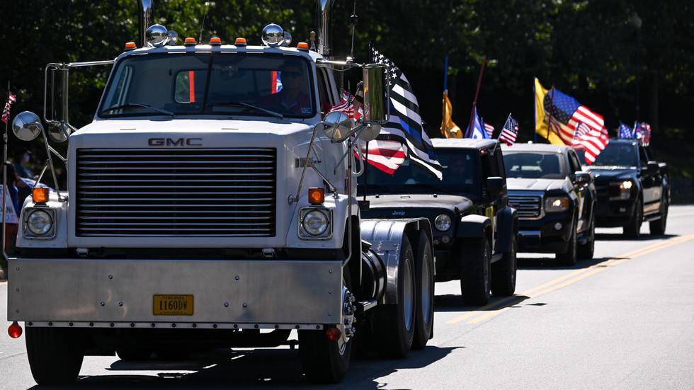 A convoy of pickup trucks