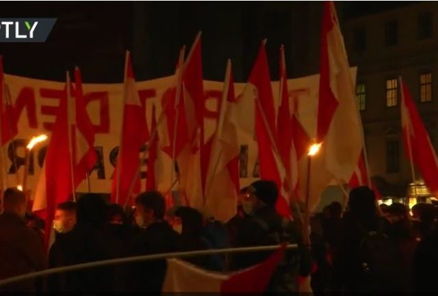 Right-wing activists hold TORCH-LIT protest in Vienna, Austria after deadly terrorist attack (VIDEO)