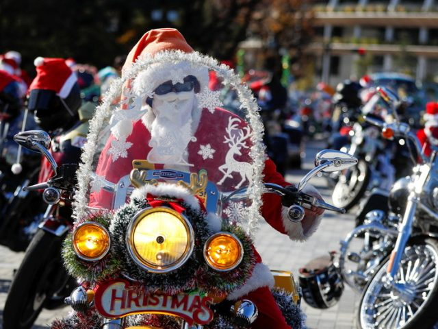 Tokyo bikers club in Santa outfits ride through city to raise awareness of violence against children (PHOTOS)