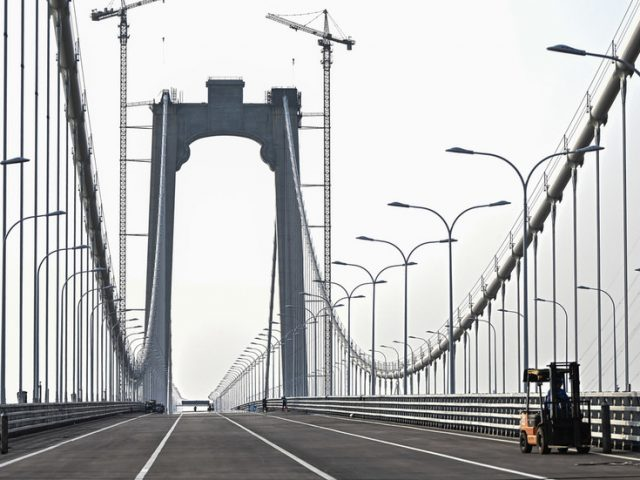 China opens world's first suspension bridge combining high-speed rail and road