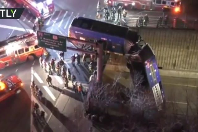 Tandem bus veers off New York road, leaving half DANGLING from overpass (PHOTOS, VIDEOS)