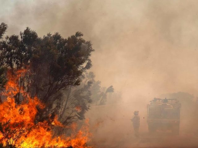 Unexploded bombs at military site hinder Australian firefighters tackling enormous 'life-threatening' blaze