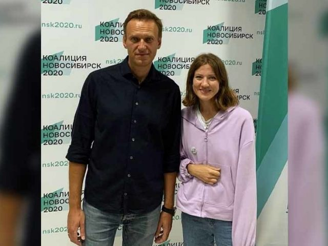 Krasnodar police probe Navalny activist over 'Putin is an enemy' comments, as Russian opposition figure prepares to fly home