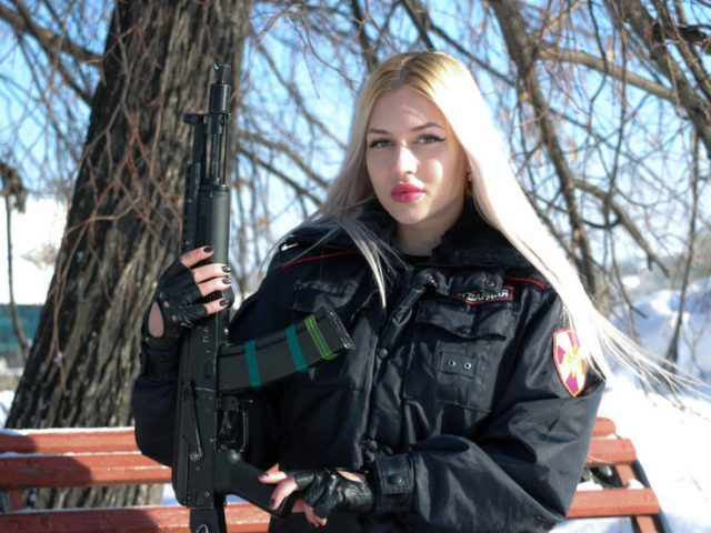 Siberian woman dubbed Russia's 'most beautiful police officer' sues service in bid to win back her badge & gun