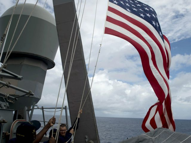 US sends warship past Chinese-controlled South China Sea islands in Biden administration first
