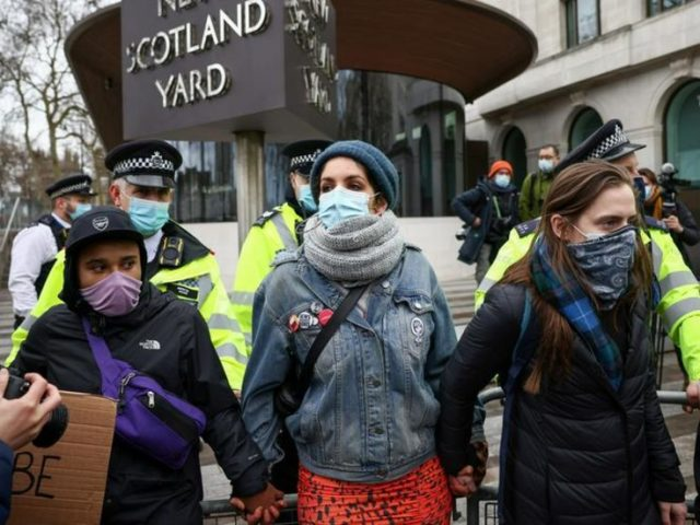 Met Police chief REFUSES to resign as protesters amass outside Scotland Yard over crackdown on Sarah Everard mourners (VIDEOS)