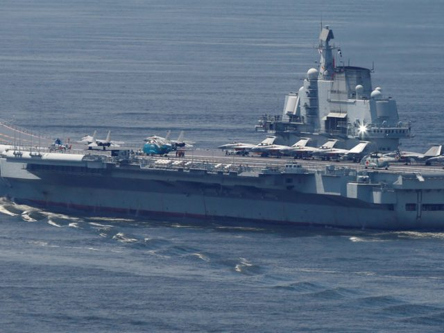 China vows to hold regular naval drills as its carrier group conducts exercises near Taiwan