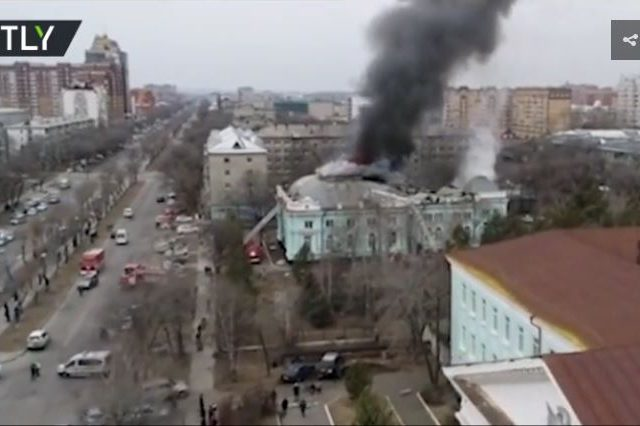 Not feeling the heat: Russian surgeons carry on with life-saving open-heart operation despite FIRE forcing evacuation of building