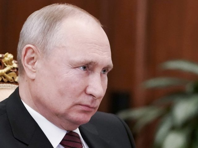 Vladimir Putin signs law enabling him to serve two more terms as Russian president, could potentially stay in office until 2036