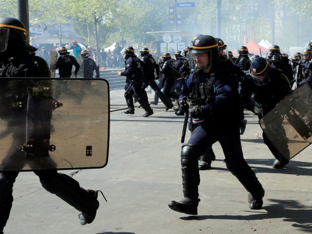 Surrounding protesters is 'illegal', top French court says in ruling against controversial government law enforcement plan
