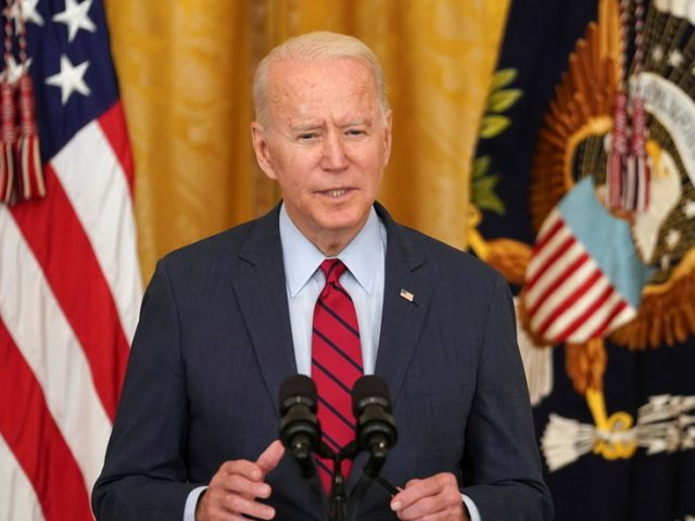 'Journalism is not a crime': Biden accuses Beijing of 'denying basic liberties' following the closure of Apple Daily