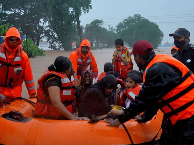 Monsoon rains trigger floods and landslides in India leaving at least 67 dead