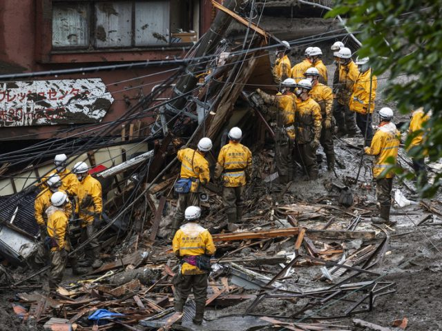 1,500 rescuers wade through mud to find survivors in wake of catastrophic landslide in Japan
