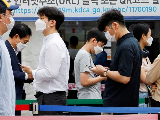 As South Korea's Covid-19 infections break records, Seoul re-imposes maximum social distancing rules