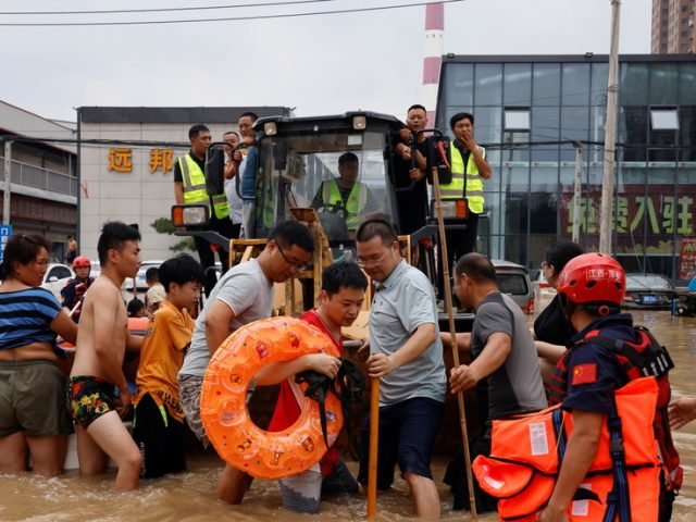 Hundreds of thousands evacuated from areas devastated by floods as China death toll rises to 33 and more rain forecast (VIDEO)