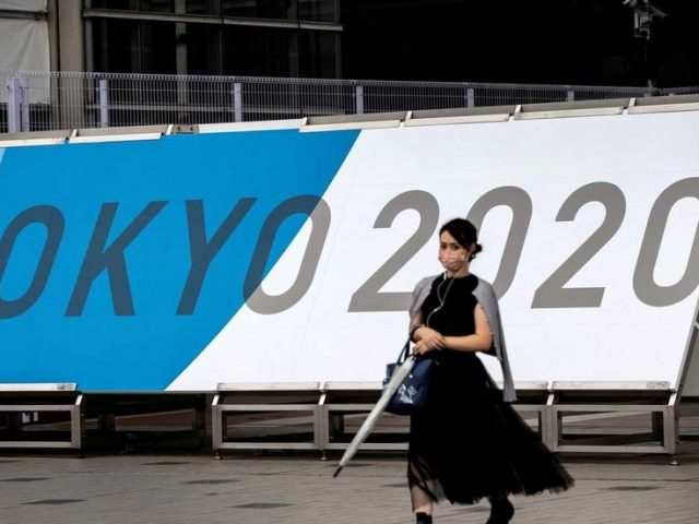 Two-thirds of Japanese don't believe Olympics organizers can pull off safe games, poll shows after Covid-19 found among athletes