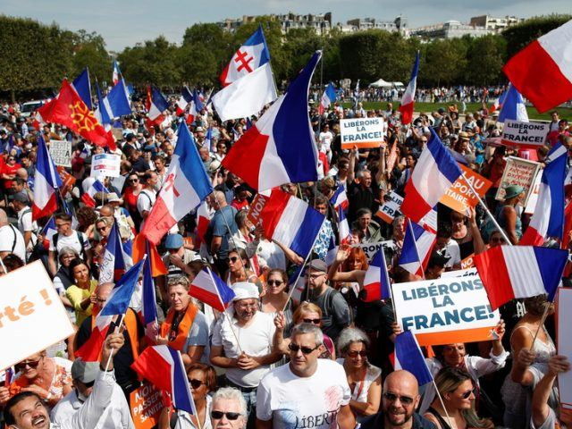 WATCH: Thousands flood Paris streets protesting against Covid-19 health passes across France